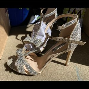 Used once INC silver bling heels